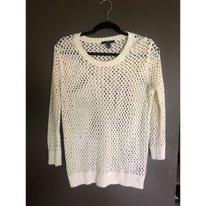 Knit open weave sweater.